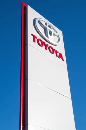 retailing: Toyota dealership sign against blue sky Editorial