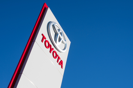 Toyota dealership sign against blue sky Editorial