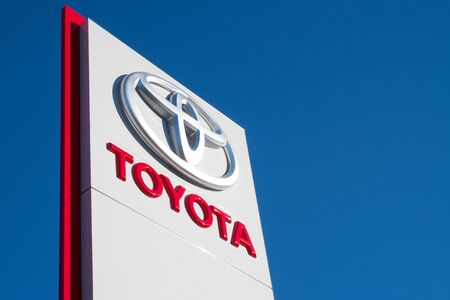 repairer: Toyota dealership sign against blue sky Editorial