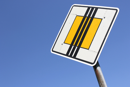 drive through: German road sign: end of priority road Stock Photo