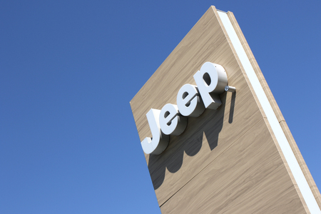 appointed: Jeep dealership sign against blue sky Editorial