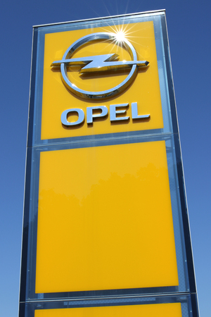 appointed: Opel dealership sign against blue sky Editorial