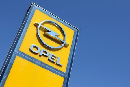 repairer: Opel dealership sign against blue sky Editorial