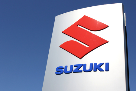 Suzuki dealership sign against blue sky