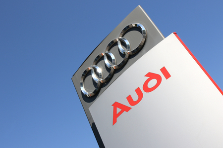 appointed: Audi dealership sign against blue sky Editorial