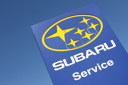 appointed: Suzuki dealership sign against blue sky