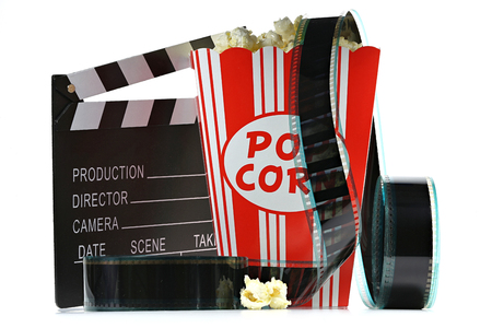 popcorn in a cardboard container with clapperboard and filmstrip isolated on white background
