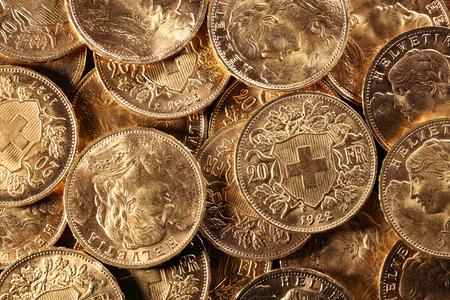 Swiss Vreneli gouden munten voor achtergrond gebruiken Stockfoto