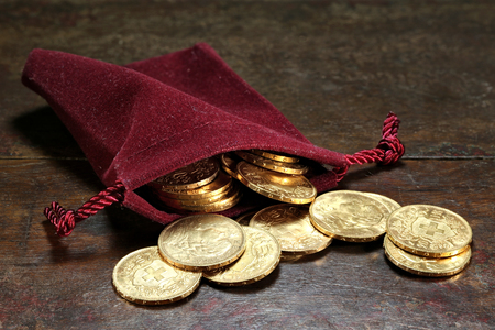 Swiss Vreneli gold coins on rustic wooden background Archivio Fotografico