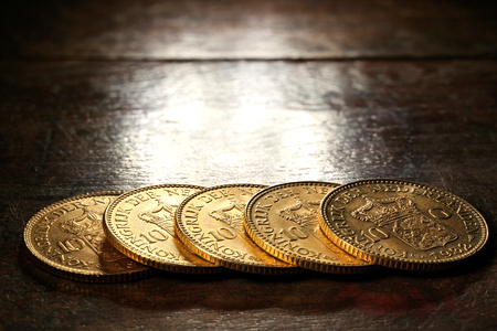 wilhelmina: Dutch Wilhelmina gold coins on rustic wooden background Stock Photo