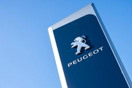 appointed: Peugeot dealership sign against blue sky