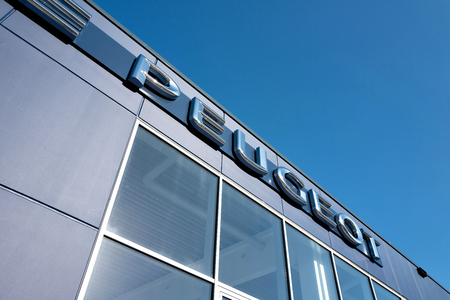 appointed: Peugeot lettering at showroom Editorial