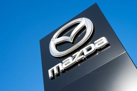 appointed: Mazda dealership sign against blue sky