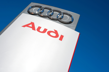 retailing: Audi dealership sign against blue sky Editorial