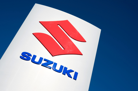 retailing: Suzuki dealership sign against blue sky