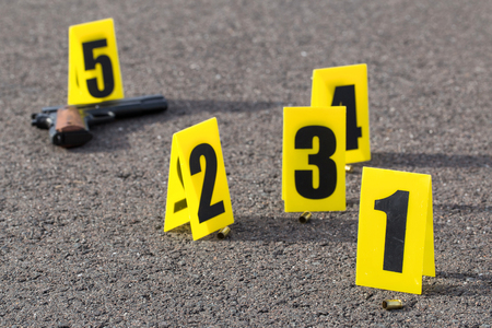 csi: ID tents at crime scene after gunfight Stock Photo