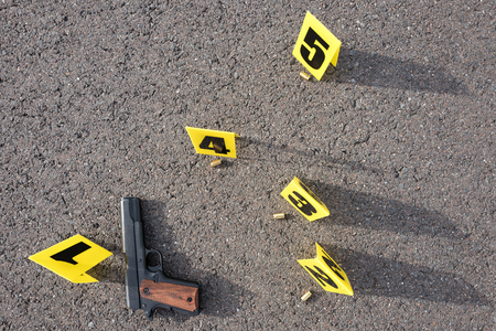 bullet proof: ID tents at crime scene after gunfight Stock Photo