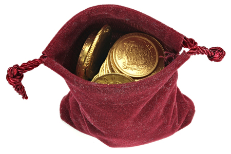 various European circulation gold coins from the 19th  20th century in a velvet purse isolated on white background