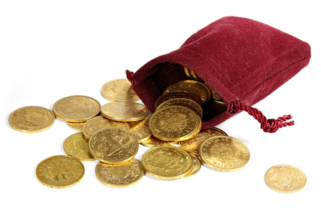moneybag: various European circulation gold coins from the 19th  20th century in a velvet purse isolated on white background