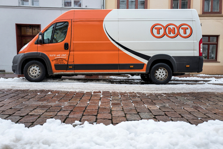 sidewall: TNT Express delivery van on a partly snow covered street