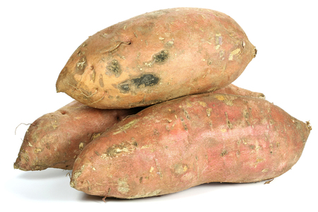 sweet potatoes from organic farming isolated on white background Stock Photo
