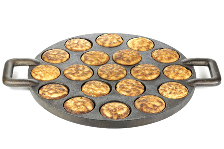 cast iron pan: homemade Dutch poffertjes in a traditional cast iron pan isolated on white background