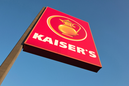 Kaiser sign against blue sky. Kaiser is a German supermarket chain owned by the Tengelmann Group but is silent in process of sale to the EDEKA Group. Editorial