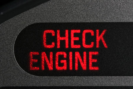check engine warning light in car dashboard