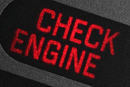 車のダッシュ ボードにエンジン警告灯を確認します。 写真素材