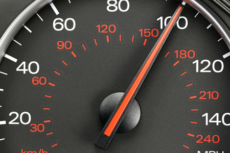 mph: speedometer at 100 mph