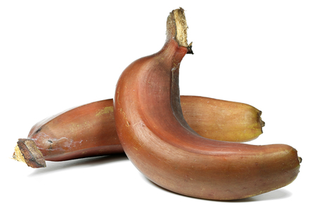 red bananas isolated on white background Stock Photo