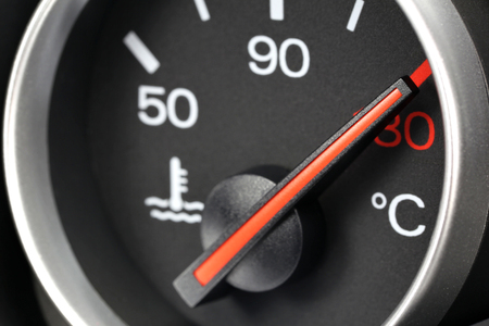 overheating: temperature gauge in car dashboard - hot Stock Photo