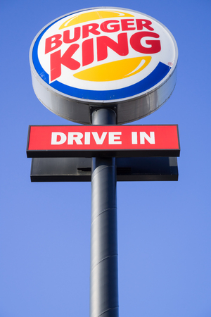 Burger King signpost against blue sky