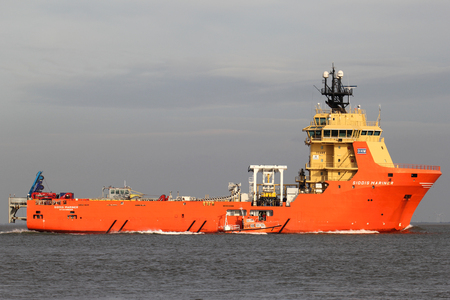 SIDDIS MARINER on the river Elbe. The SIDDIS MARINER is a diesel electric driven supply vessel and pipe carrier, owned and operated by Siem Offshore. Editorial