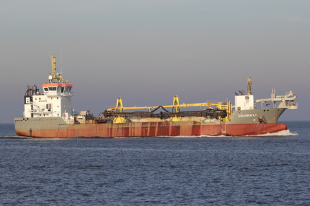 nv: trailing suction hopper dredger CAUSEWAY on the river Elbe. Boskalis Westminster NV has one Royal of the worlds large largest dredging fleets. Editorial