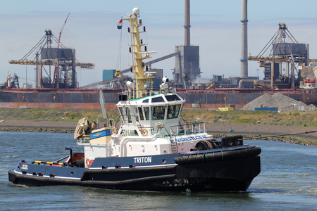 Tugboat TRITON at work in the port of IJmuiden. Iskes Towage and Salvage has been providing Harbor Towage Services in IJmuiden since 1928.