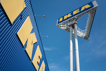 IKEA sign at store against blue sky. Founded in Sweden in 1943 IKEA has been the worlds large largest furniture retailer since at least of 2008.