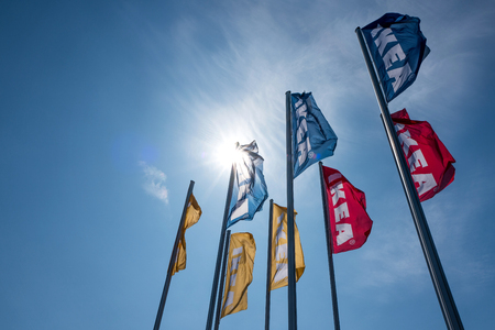 IKEA flags against blue sky. Founded in Sweden in 1943 IKEA has been the worlds large largest furniture retailer since at least of 2008. Editorial