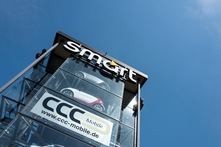 smart tower against blue sky. Smart is a German automotive company and division of Daimler AG. Imagens - 77863571