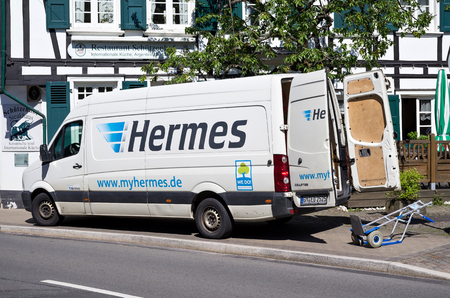 sidewall: Hermes delivery van in front of a half-timberhouse. Hermes is Germanys largest post-independent provider of deliveries to private customers. Editorial