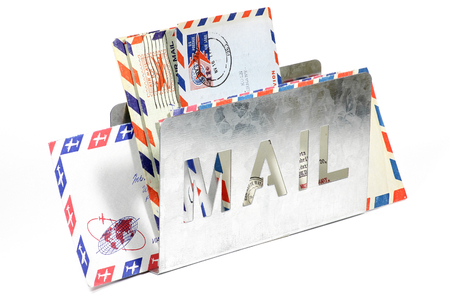 penfriend: airmail letters in metal holder isolated on white background