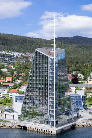 lodgings: Seaside view of Scandic Seilet Hotel, opened on 11 September 2002. At 16 floors and 82 meters, it is the tallest building in the town of Molde, Norway.