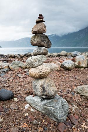 balanced stack of stones at Eidfjorden, Norway Stock Photo