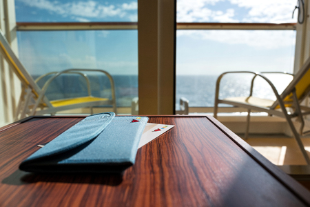 AIDA briefcase for travel documents in ship cabin with balcony. AIDA Cruises is one of ten brands owned by Carnival Corp.