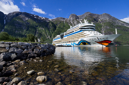 AIDAsol at Eidfjord Cruise Terminal, Norway. AIDAsol is a Sphinx class cruise ship, built at Meyer Werft for AIDA Cruises, one of ten brands owned by Carnival Corp.
