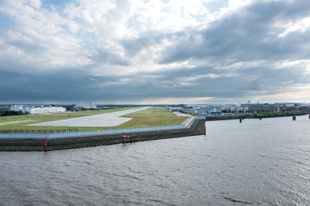 exclusively: Riverside view of Hamburg Finkenwerder Airport. It is part of the Hamburg plant of Airbus and is exclusively used by them for corporate, freight, test and delivery flights. Editorial