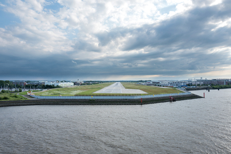 Riverside view of Hamburg Finkenwerder Airport, Germany. It is part of the Hamburg plant of Airbus and is exclusively used by them for corporate, freight, test and delivery flights.