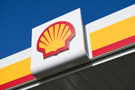 Shell sign against blue sky. Shell is an Anglo-Dutch multinational oil and gas company headquartered in the Netherlands and incorporated in the UK. Editorial
