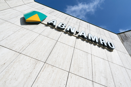 ABN AMRO sign at branch. ABN AMRO is the third-largest bank in the Netherlands. Sajtókép