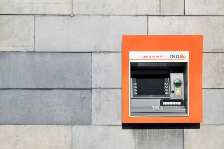ING cash dispensing machine. ING is a Dutch multinational banking and financial services corporation headquartered in Amsterdam. Editorial